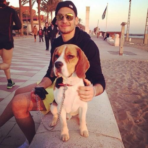 Пауло Гассанига с псом