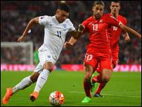 Алекс Окслейд-Чемберлен против сборной Швейцарии